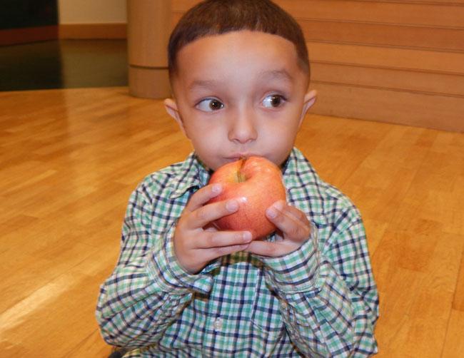 Kyrie enjoying an apple