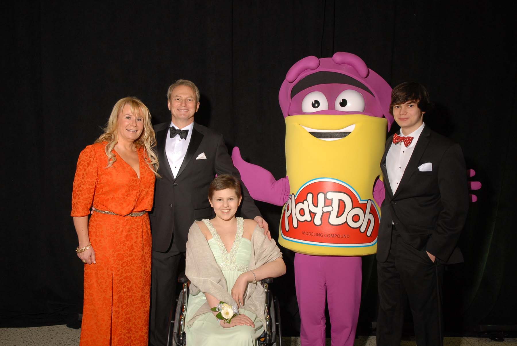 Featured patient Emma Katzen and her family with a PLAY-DOH character. Photo by Al Weems.